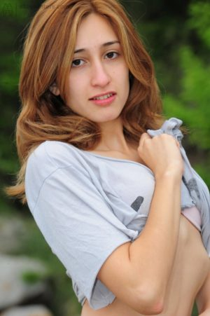 Unshaved redhead Grisel posing outside
