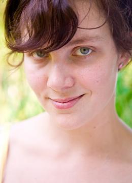 Short haired brunette Immie naked and masturbating outside