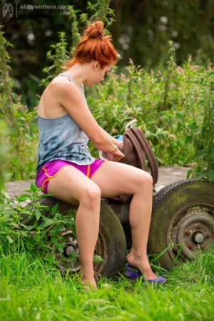 Cute amateur redhead Flora fingering her bush in a van