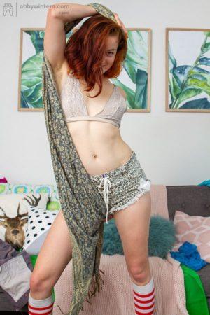 Nerdy cute redhead Sophia G wearing socks and flaunting her hairy minge